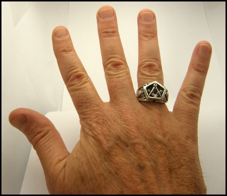 Mortality Masonic Ring displayed on averaged sized hand